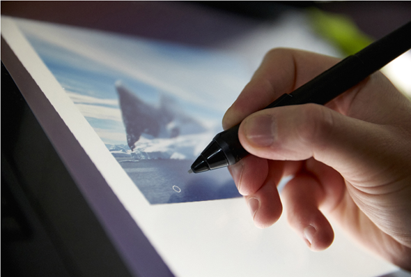 game developer using a graphics tablet